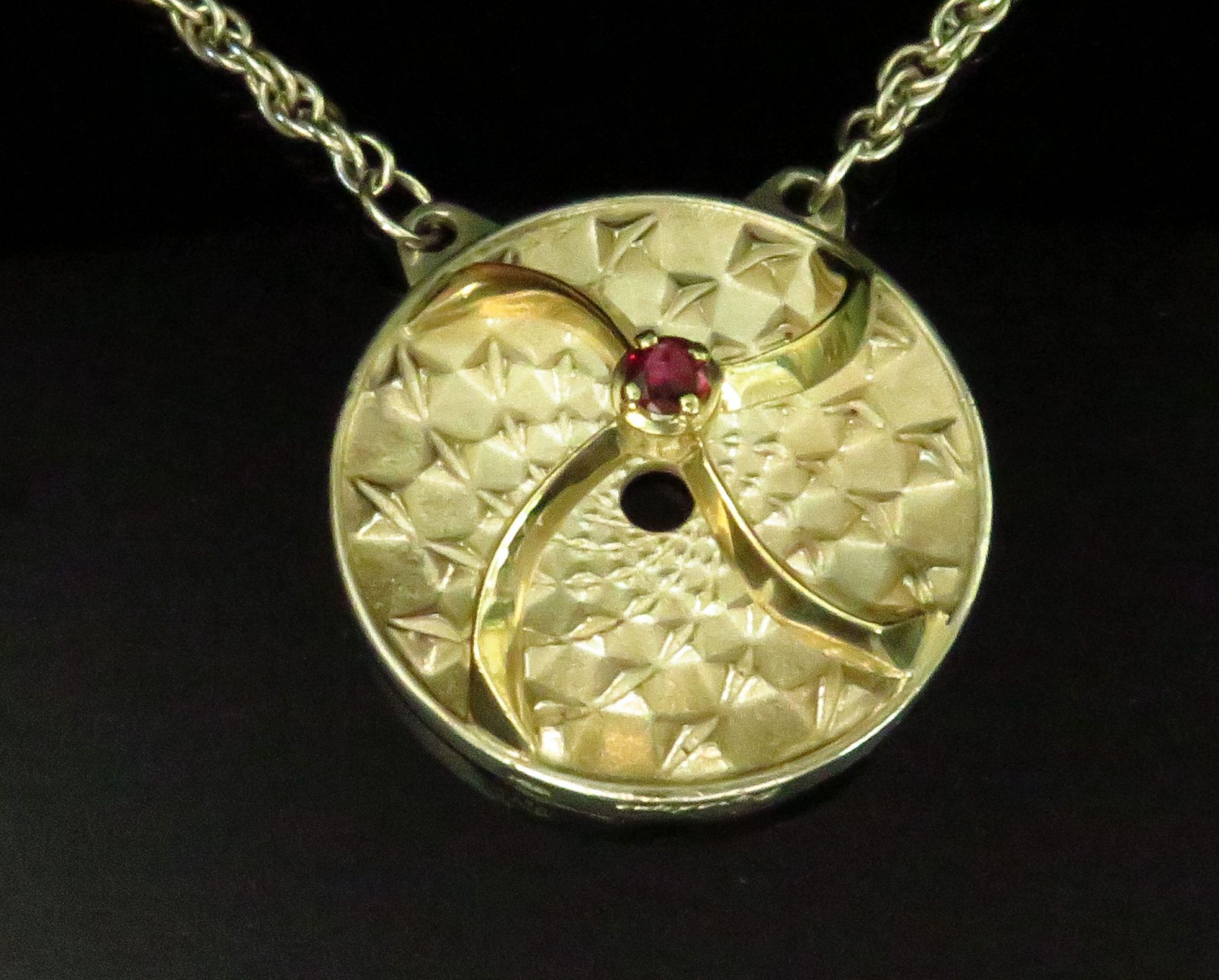 Gold, Sterling and Garnet Pyradyne Nuclear Receptor