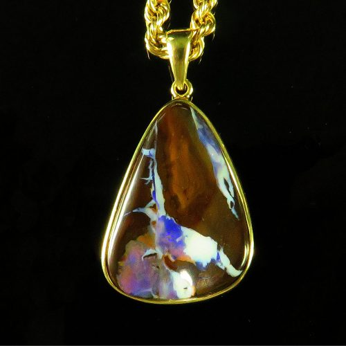 Free Form Boulder Opal in Gold Pendant