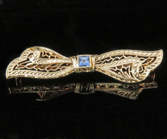 Edwardian Platinum and Gold Sapphire Filigree Bow Brooch