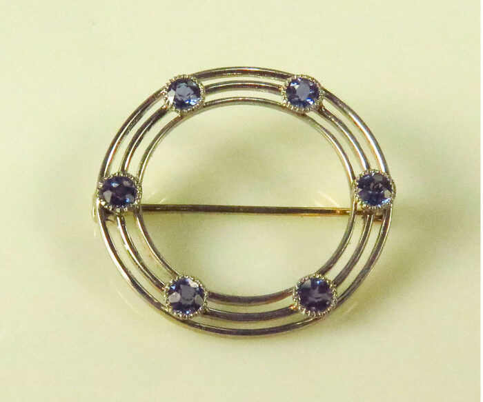 Edwardian Platinum Topped Circle Pin with Sapphires