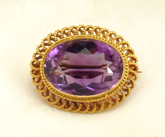 Gold Amethyst Brooch with Twisted Wire Frame