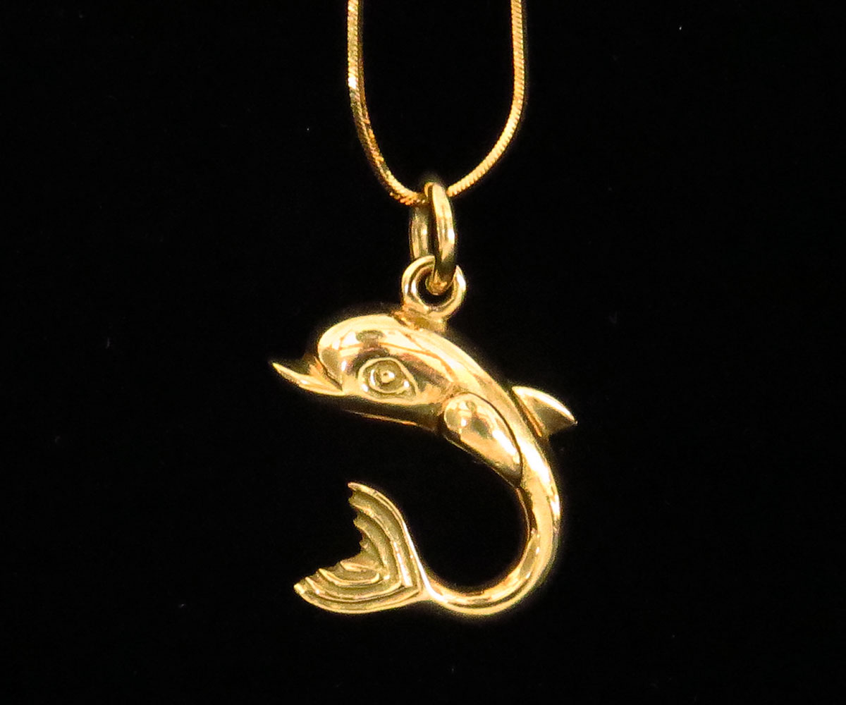 Gold Dolphin Pendant on a Chain