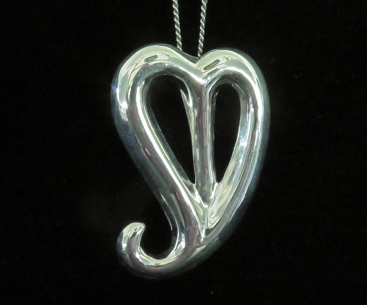 Sterling Heart Pendant with a Tail